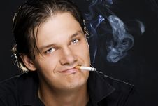 Man Smoking A Cigarette Royalty Free Stock Photos