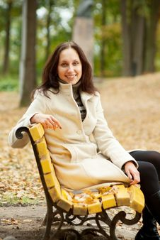 Free Young Woman Sitting On Bench And Smilling Stock Images - 16394934