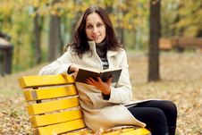 Free Young Woman Sitting On Bench In Autumn Park Royalty Free Stock Photo - 16394955