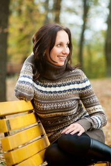 Free Young Woman Sitting On Bench And Smiling Royalty Free Stock Images - 16394979