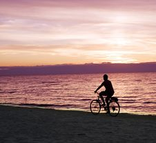 Free Bicyclist On The Beach Stock Photo - 16395120