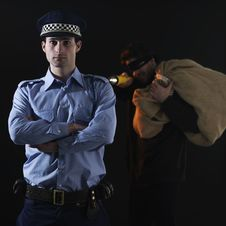 Free Policeman And Thief. Robbery Scene. Royalty Free Stock Photography - 16395787
