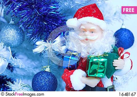 Free Santa Claus And Christmas Tree Royalty Free Stock Photography - 1648167