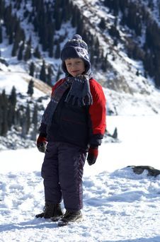 Free Boy And Winter Mountains Stock Photo - 1642140