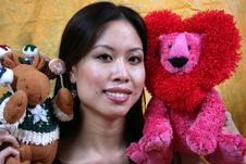 Asian Girl And Stuffed Animals Royalty Free Stock Images