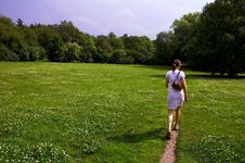 Free Girl Walking Through Meadow Royalty Free Stock Photography - 1643907