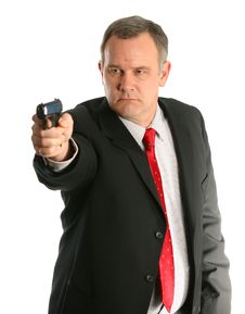 Free Businessman Or Federal Agent Pointing Handgun Stock Photography - 1643942