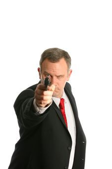 Free Businessman Or Federal Agent Pointing Handgun Royalty Free Stock Photo - 1643945