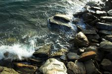 Free Water Surging Over Rocks In The Sea Stock Image - 1646211