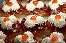 Free Small Cupcakes With Cream And Cherry 2 Royalty Free Stock Image - 1647136