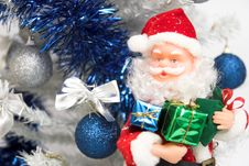 Santa Claus And Christmas Tree Stock Images