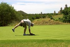 Golfer On The Green. Stock Photography
