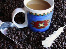 Free Cup Of Coffee On Pile Of Beans Royalty Free Stock Images - 16401139
