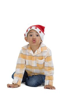 Boy With Santa Claus Hat Stock Photos