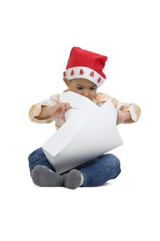 Boy Opening Christmas Gift Royalty Free Stock Image