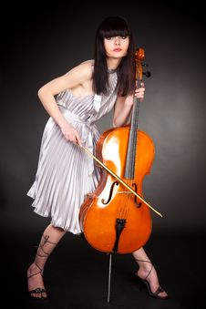Free Brunette Girl With Cello Royalty Free Stock Images - 16409819
