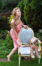 Free Attractive Blond Girl In The Pink Dress In The Gar Stock Photography - 16414602