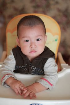 Free Baby On Chair Royalty Free Stock Photo - 16410635