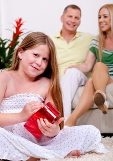 Free Cute Girl Opening Christmas Gift With Parents Royalty Free Stock Photo - 16412225