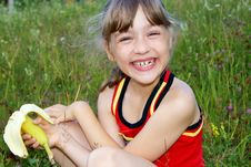 Free The Girl Eats A Banana And Laughs Royalty Free Stock Photography - 16412637