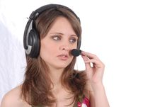 Successful Female Call Centre Employee Speaking Ov Stock Photography