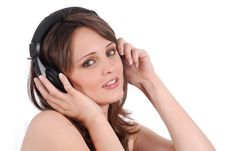 Free Girl Listening To Musicthrough Headphones Isolated Royalty Free Stock Image - 16418206