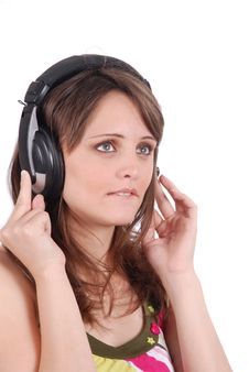 Free Girl Listening To Musicthrough Headphones Isolated Royalty Free Stock Images - 16418209