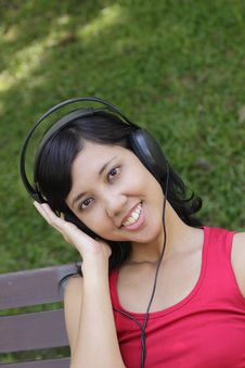 Free Woman Listening To Music Stock Photo - 16419360