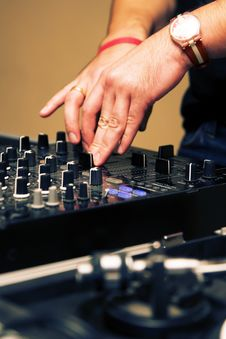 Free DJ Adjusting Sound Level On Mixer Stock Images - 16419934