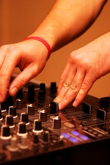 Free DJ Adjusting Sound Level On Mixer Royalty Free Stock Photography - 16419947