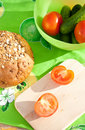 Free Tomatoes On The Cutting Board With Rye Bread Stock Images - 16428174