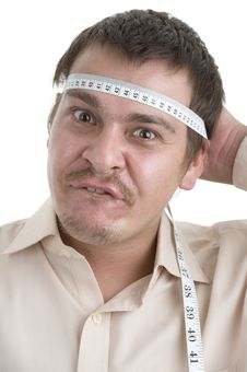 Free Man Measuring His Head Stock Images - 16420214