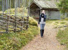 Girl Walking Along Woodland Path Stock Images