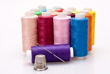 Free Colored Thread For Sewing With Needle And Thimble Royalty Free Stock Photos - 16421588