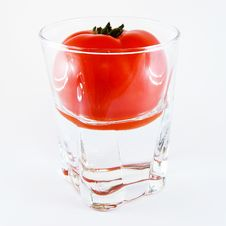 Tomato In A Glass Of Water Isolated Stock Images