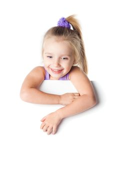Smiling Little Girl Looking Over Empty Board Stock Images