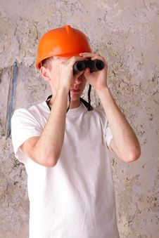 Builder Looking Through Binoculars Royalty Free Stock Photo