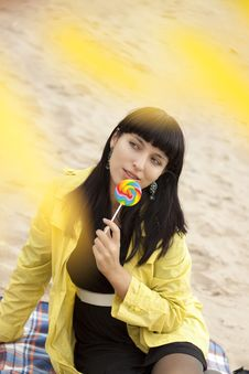 Free Woman Eating Candy Lollipops Royalty Free Stock Images - 16428949