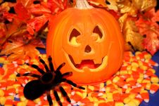 Jack O Lantern With Candy And A Spider Royalty Free Stock Photography