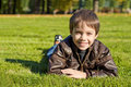 Free Little  Boy Lying Down On The   Grass Royalty Free Stock Photography - 16431207