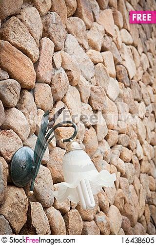 Wall lamp on stone wall Stock Photo