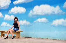 Beauty Girl On The Background Of Sky. Royalty Free Stock Image