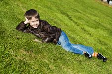 Free Little Boy Lying Down On The  Grass Stock Photo - 16431200