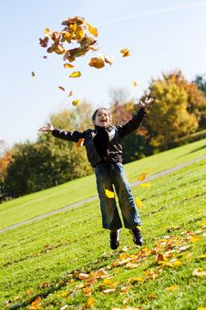 Free Little Boy Throwing Up  Autumn  Leafes Stock Photography - 16431212