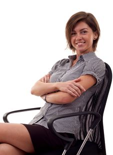Free Woman Sitting On Office Chair Royalty Free Stock Image - 16433196