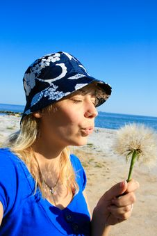 Free Woman Blowing Dandelion Seeds Royalty Free Stock Images - 16433279