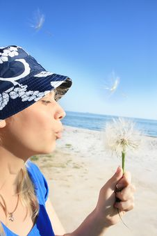 Free Woman Blowing Dandelion Seeds Royalty Free Stock Photography - 16433287