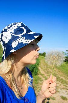 Free Woman Blowing Dandelion Seeds Stock Photo - 16433290