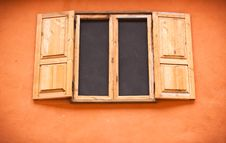 Free Vintage Window On Orange Wall Stock Images - 16439004