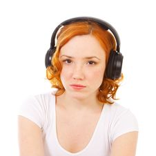 Free Redhead Girl Listening Music In Headphones Royalty Free Stock Photo - 16439355